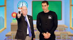 Cheap shot: Sacha Baron Cohen with gun rights activist Philip Van Cleave in Who is America?