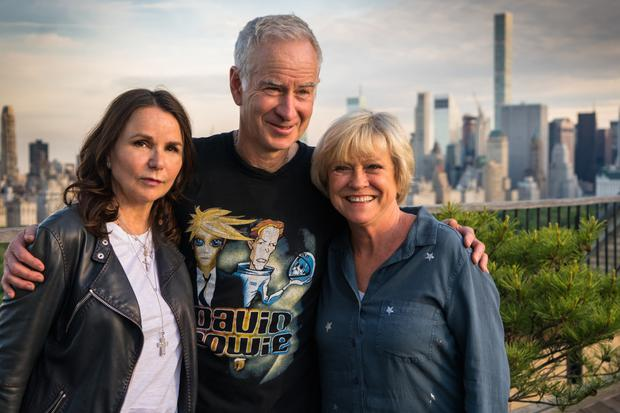 Silver server: John McEnroe with wife Patty Smyth (left) and Sue Barker (right)