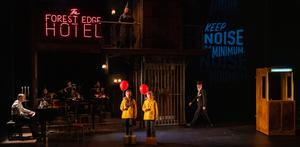 Conductor Richard Peirson (at piano), Amelie Metcalfe and Ronan Millar (the lost children), and Raymond Keane (the night porter) in the INO/Theatre Lovett production of Hansel and Gretel