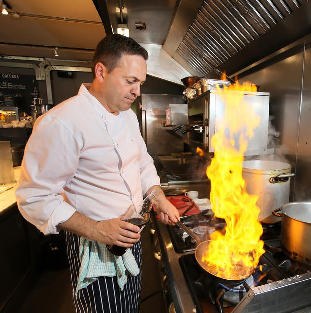 Hot in the kitchen: Chef Liam Moloughney rustles up kidneys. Photo: Frank McGrath