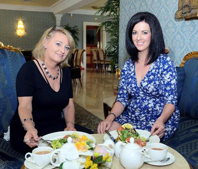 Storm and a teacup: Rebecca Storm and Deirdre Reynolds catch up over lunch at Palmerstown House Estate in Kildare, near the singer's home. Photo: Dave Meehan.