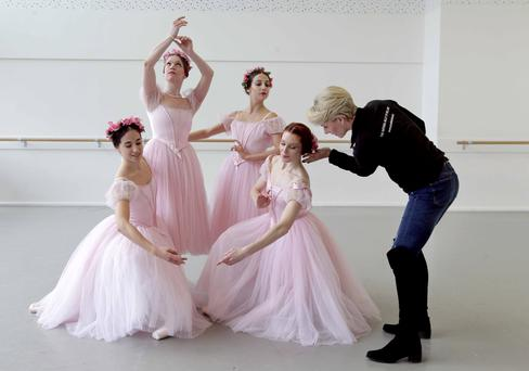 Ballet Ireland director Anne Maher puts the finishing touches to Ballet Ireland dancers (left to right) Maria Ledesma from Spain, Celine Le Grelle from Belgium, Simona Marsibilio from Italy, and Jane Magan from Rathfarnham, Dublin
