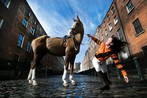 Horsing around: Dancer Emma O'Kane and George the horse in Dublin's Henrietta St. Emma O'Kane will star in WillFredd Theatre's new production Jockey