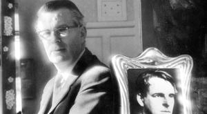 Michael Yeats with a portrait of his father.