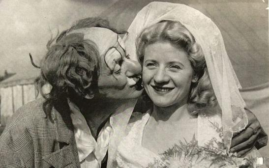 Olga Kerr is kissed by her father Coco the Clown on her wedding day