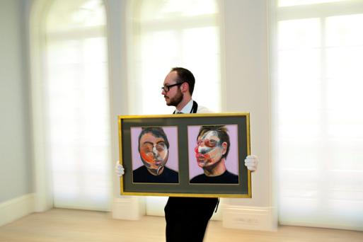 A Sothebys employee with Two Studies For A Self-Portrait by Francis Bacon