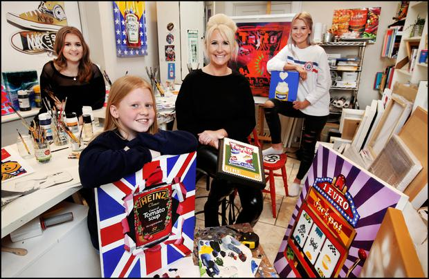 Family affair: Orla in her studio with children (from left) Ali (18), Tess (11) and Charlie (16). Photo: Steve Humphreys