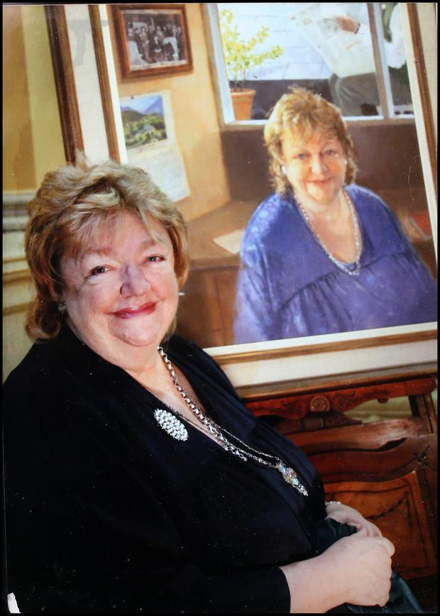 Maeve Binchy in 2005 alongside a portrait of herself by Maeve McCarthy.