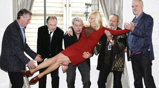 The surviving Pythons line up with actress Carol Cleveland.