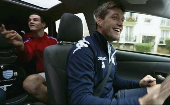 Ronan O'Gara driving with Johnny Sexton in the back of his car in Paris