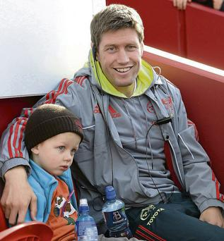 Ronan O'Gara and with his son, Rua