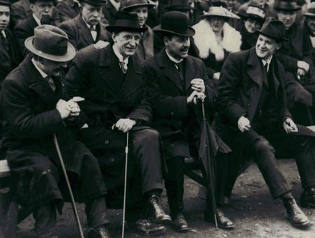 Michael Collins (far right) himself told a Cork newspaper in 1922 that he was not convinced in retrospect that IRA violence in and of itself did the trick. Also pictured (l-r): Arthur Griffith, Éamon de Valera, Laurence O'Neill, and Michael Collins. Photo: RTE