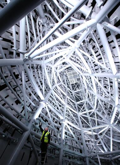 Electrical Engineer Stewart Donaghy inside one of the Kelpies as a lighting test is carried out on the Kelpies in Falkirk ahead of their  official opening to the public later this month. PRESS ASSOCIATION Photo. Picture date: Monday April 7, 2014. Designed by sculptor Andy Scott each of The Kelpies stands up to 30 metres tall and each one weighs over 300 tonnes. They are constructed of structural steel with a stainless steel outer skin, they pay homage to the tradition of working horses of Scotland which used to pull barges along Scotland's canals.  They stand at the entrance to the North Sea at the Forth and Clyde canal. Photo credit should read: Andrew Milligan/PA Wire