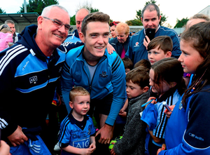Dublin midfielder Brian Fenton poses with supporters of all ages at the team's Open Night, which was held in Parnell Park on Wednesday ahead of the All-Ireland SFC final against Kerry