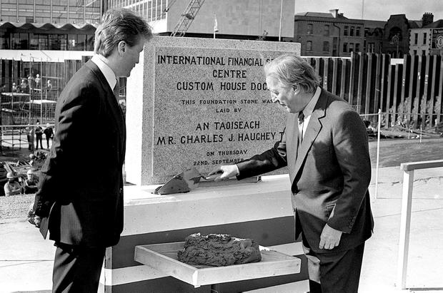 Taoiseach Charles Haughey laying the foundation stone of the International Financial Services Centre at Custom House dock site with Mark Kavanagh, Chairman, Custon House Docks Development Co. Ltd. Photo: Tony Reddy