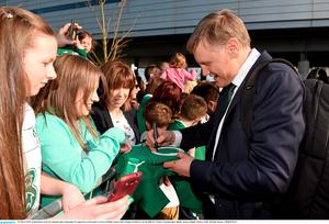 22 March 2015; Ireland head coach Joe Schmidt signs autographs for supporters on the team's arrival at Dublin Airport after beating Scotland to win the RBS Six Nations Championship. Dublin Airport, Dublin. Picture credit: Brendan Moran / SPORTSFILE