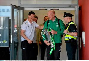 22 March 2015; Ireland captain Paul O'Connell and Jonathan Sexton share a joke on the team's arrival at Dublin Airport after beating Scotland to win the RBS Six Nations Championship. Dublin Airport, Dublin. Picture credit: Brendan Moran / SPORTSFILE