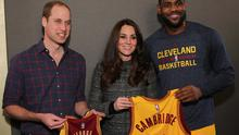 Britain's Prince William, left, and Kate pose with Cleveland Cavaliers' LeBron James, right, backstage of an NBA basketball game between the Cavaliers and the Brooklyn Nets