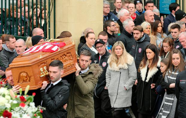 Family and friends follow the coffin at Ryan McBride's funeral in Derry. Photo: Gerry Mooney