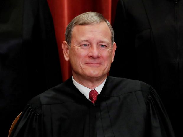 Chief Justice of the United States John G. Roberts is seen during a group portrait session for the new full court at the Supreme Court in Washington, US. November 30, 2018. REUTERS/Jim Young