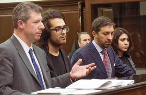 Max Rosenblum (2nd L) and Juliana Luchkiw (R) are pictured in court with defense attornies Stephen Turano and Daniel Hochheiser (L) during their arraignment in New York February 5, 2014. Three men and one woman arrested in New York have been charged with drugs offences possibly connected to narcotics found at the home of film star Philip Seymour Hoffman following his death of an apparent heroin overdose, law enforcement officials said. REUTERS/Steven Hirsch/Pool   (UNITED STATES - Tags: ENTERTAINMENT CRIME LAW)