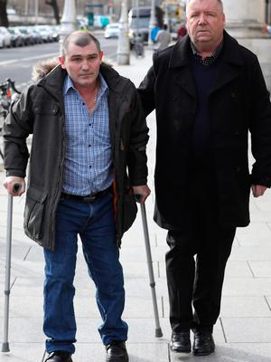 John Breen and George Davis, pictured leaving the Four Court after a Circuit Civil Court action.Pic: Collins Courts