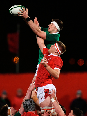 Thomas Ahern of Ireland wins possession in a line-out ahead of Ben Carter of Wales. Photo by Harry Murphy/Sportsfile