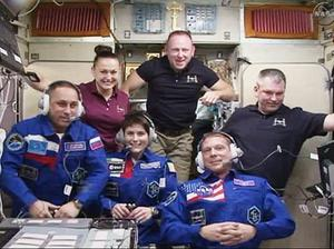 This November 2014 image made from a frame grabbed from NASA-TV, shows Expedition 42 crew members, front row from left, Anton Shkaplerov, Samantha Cristoforetti and Terry Virts, and back row from left, Elena Serova, Commander Barry Wilmore and Alexander Samokutyaev, while on the International Space Station in the Zvezda service module during a traditional crew greeting ceremony with family and mission officials on the ground.  (AP Photo/NASA-TV)