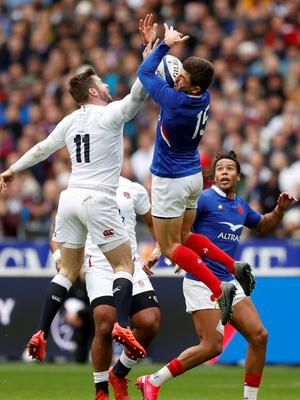 England's Elliot Daly in action with France's Anthony Bouthier as Teddy Thomas looks on. Photo: Gonzalo Fuentes/Reuters