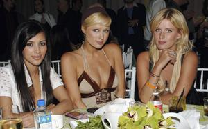 """HOLLYWOOD - JUNE 01:  (L-R) Kimberly Kardashian, actor Paris Hilton and sister designer Nicky Hilton attend the after party following the premiere of HBO's """"Entourage"""" at the Hollywood Social on June 1, 2006 in Hollywood, California.  (Photo by Stephen Shugerman/Getty Images)"""