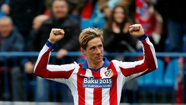 Atletico Madrid's Fernando Torres celebrates after scoring a goal against Getafe during their Spanish first division soccer match at Vicente Calderon stadium in Madrid (REUTERS/Sergio Perez)