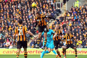 Nikica Jelavic of Hull City clears a cross during the Barclays Premier League match between Hull City and Tottenham Hotspur
