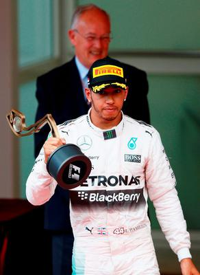 Lewis Hamilton of Great Britain and Mercedes GP reacts on the podium after finishing third during the Monaco Formula One Grand Prix at Circuit de Monaco on May 24, 2015 in Monte-Carlo, Monaco.  (Photo by Paul Gilham/Getty Images)
