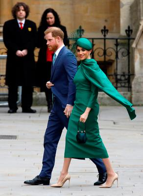 Britain's Prince Harry, Duke of Sussex, (L) and Meghan, Duchess of Sussex arrive to attend the annual Commonwealth Service at Westminster Abbey in London on March 09, 2020