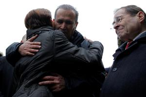 Iraqi immigrant Hameed Darwish embraces Congresswoman Nydia Velazquez with Congressman Jerrold Nadler (R) after being released at John F. Kennedy International Airport in Queens, New York, U.S., January 28, 2017.  REUTERS/Andrew Kelly
