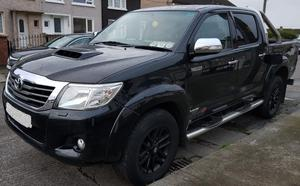 A Toyota Hilux was among the high-end vehicles seized by the Criminal Assets Bureau in raids at five locations in Dublin yesterday