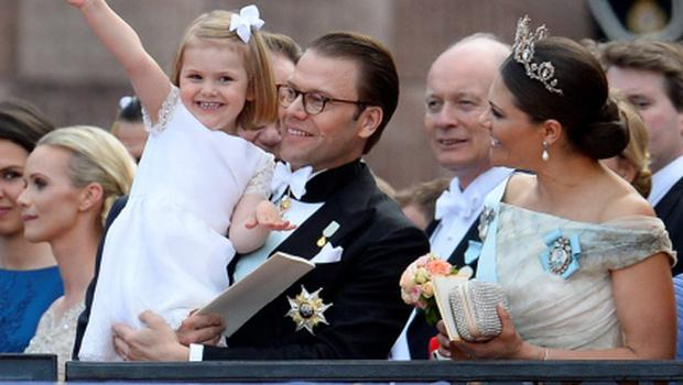 TOPSHOTS Princess Estelle waves to the crowds held by her father Sweden's Prince Daniel, next to Sweden's Crown Princess Victoria outside the Stockholm Palace after the wedding ceremony of Sweden's Crown Prince Carl Philip and Princess Sofia on June 13, 2015. AFP PHOTO / JONATHAN NACKSTRANDJONATHAN NACKSTRAND/AFP/Getty Images