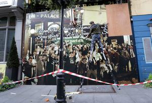 'Missing the craic': Dave O Rourke of Creative Dave hangs a mural on the boarded-up Palace Bar in Dublin. Photo: Frank McGrath