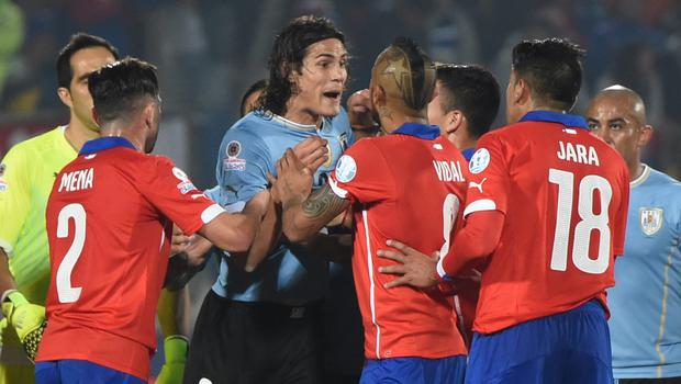 An Uruguayan newspaper shows a picture of the incident involving Gonzalo Jara and Edinson Cavani