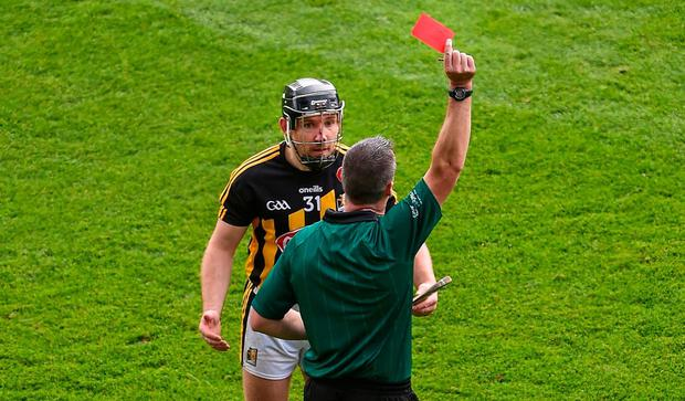 OFF: Referee James Owens shows Kilkenny's Richie Hogan a red card for his challenge on Tipperary's Cathal Barrett in the All-Ireland hurling final. Photo: Daire Brennan/Sportsfile