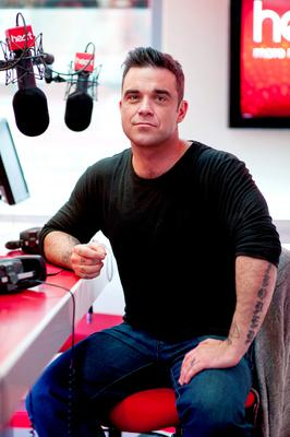 Robbie Williams pictured during an interview on Heart FM at their studio in Leicester Square, London, in 2012. PA Wire