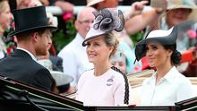 Britain's Prince Harry, Duke of Sussex, (L) and his wife Britain's Meghan, Duchess of Sussex (R) arrive with Britain's Sophie, Countess of Wessex, on day one of the Royal Ascot horse racing meet, in Ascot, west of London, on June 19, 2018