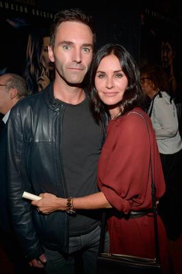 """Johnny McDaid (L) and actress Courteney Cox attend the Amazon premiere screening for original drama series """"Hand Of God"""" at The Theatre at Ace Hotel on August 19, 2015 in Los Angeles, California.  (Photo by Charley Gallay/Getty Images for Amazon Studios)"""