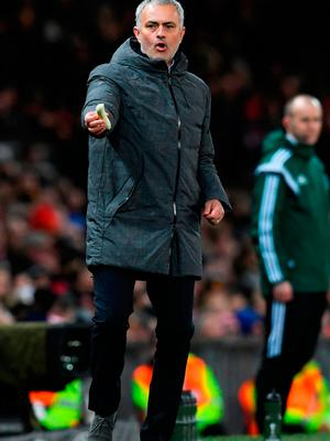 Jose Mourinho gives a banana to Marcos Rojo during last night's match at Old Trafford STU FORSTER/GETTY IMAGES