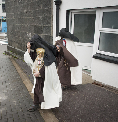 Hiding: The Carmelite nuns hurry away from the court with the Child of Prague statue. Photo: Daragh McSweeny