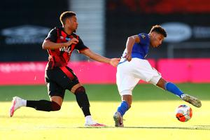 Bournemouth's Arnaut Danjuma and Leicester City's James Justin battle for the ball. Photo: PA