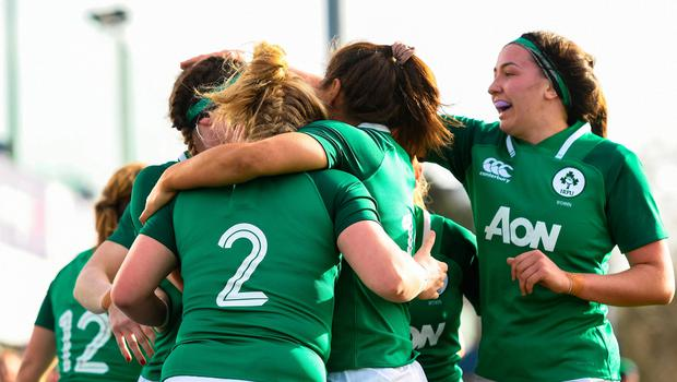 Cliodhna Moloney of Ireland celebrates with team-mates after scoring her side's first try