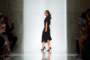 Designer Victoria Beckham acknowledges attendees after presenting her Spring/Summer 2016 collection during New York Fashion Week