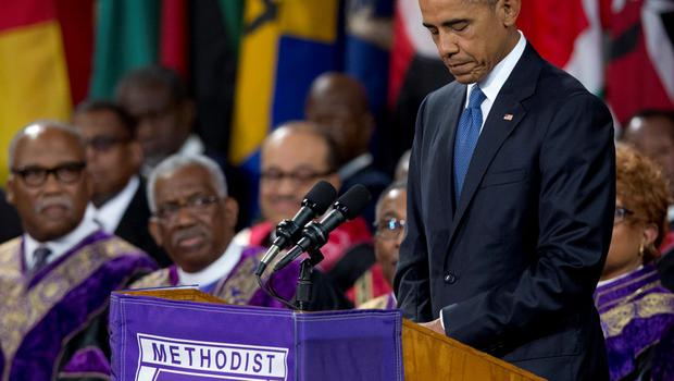 President Barack Obama pauses as he speaks during services honoring the life of Rev. Clementa Pinckney, Friday, June 26, 2015, at the College of Charleston TD Arena in Charleston, S.C.. Pinckney was one of the nine people killed in the shooting at Emanuel AME Church last week in Charleston. (AP Photo/Carolyn Kaster)