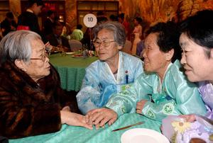 South Korean Kim Sung-Yoon (L), 96, meets with her North Korean sisters during a family reunion after being separated for 60 years